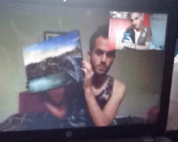 Showing off the unharmed painting on Skype.